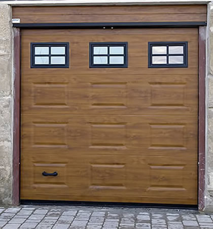 Puertas de garaje baratas y de gran calidad for Puerta garaje basculante precio